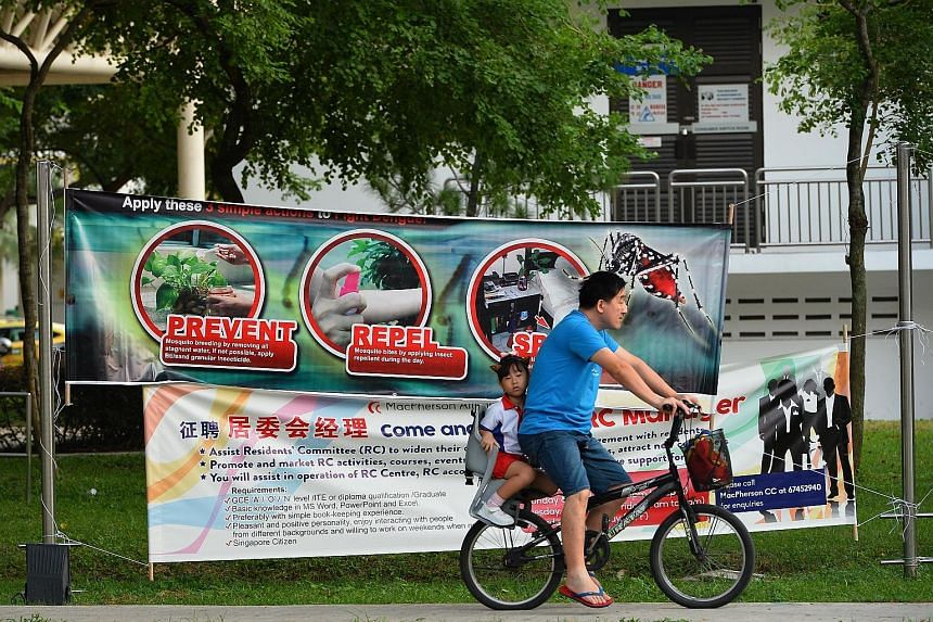 Above: Geylang Methodist School (Primary) pupils heading to school yesterday morning. The school, which is in the Aljunied area, had its compound fumigated last Saturday to prevent mosquito breeding. Below: A dengue-prevention banner in Aljunied Cres