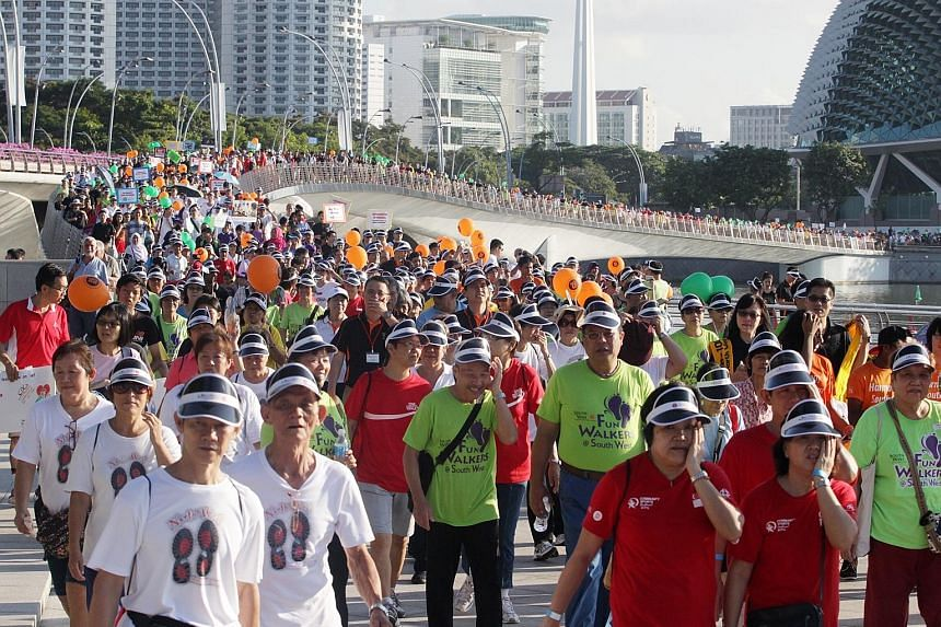 More than 5,000 people took part in a 21/2km community parade cum brisk walk at Marina Bay last year. Walking is the most popular physical activity among Singaporeans.