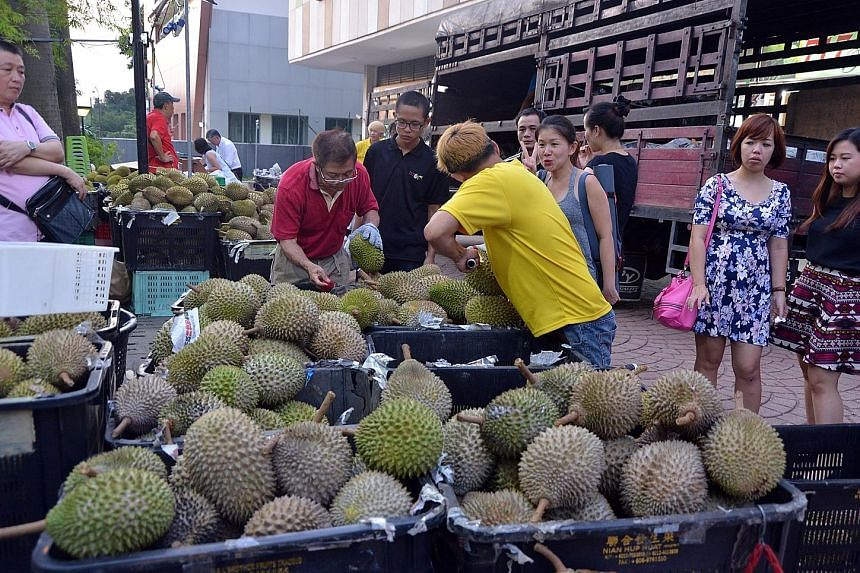 Fruit stall 717 Trading brings in about 50 baskets of durians a day, down from 200 during the peak of the harvest season.