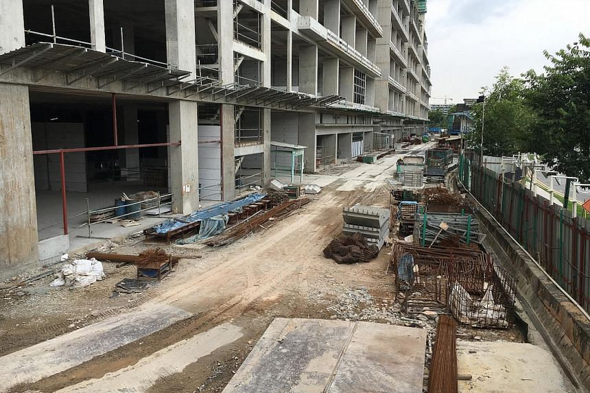 The Mega@Woodlands construction site for an eight-storey industrial factory development. A formwork panel fell seven storeys over the edge of the building, taking the 33-year-old construction worker with it. He was pronounced dead at the scene.
