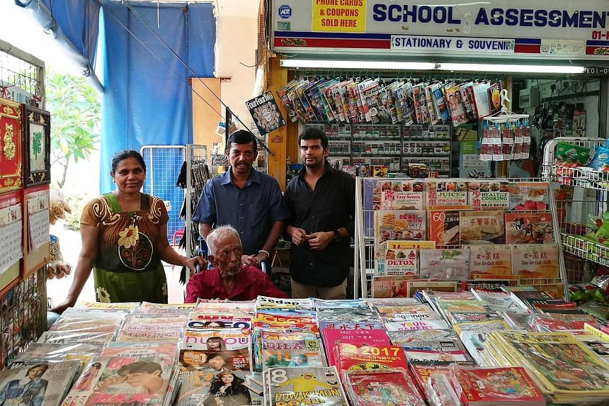 Yorkland Traders owner K. Mohan Raj (centre, in blue) with his father R. Krishnavenu (seated) and shop assistants, Madam R. Pommi and Mr R. Selvaraj. The magazine and sundry shop in Aljunied is among HDB businesses that stand to benefit from the late