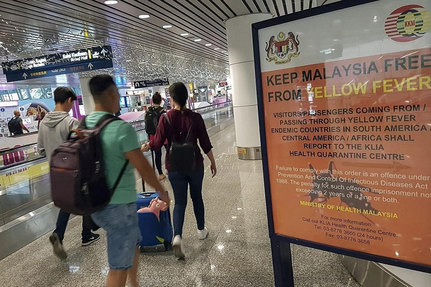 A travel advisory on yellow fever at Kuala Lumpur International Airport. Those returning to Malaysia from Zika-hit countries have been urged to go for testing.