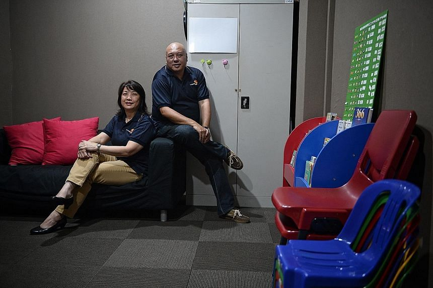 Ms Jolene Ong, 53, chairman and founder of The Silver Lining Community Services, and Mr Kelvin Tay, 50, a board member and counsellor at the organisation. Ms Ong noted that for people earning less than $2,000 a month, the amount of debt owed to legal