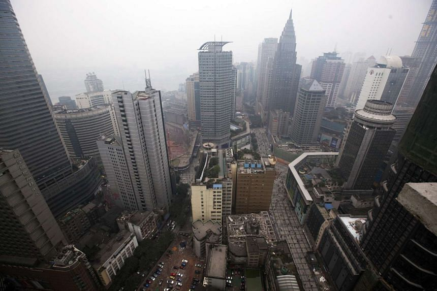 Residential and commercial buildings rise in the skyline in Chongqing, China, on Jan 25, 2011.