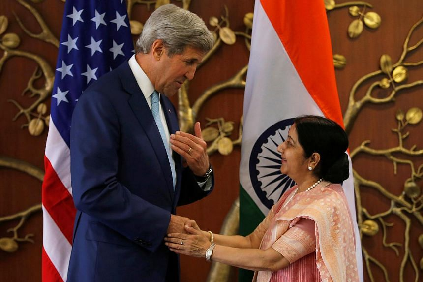US Secretary of State John Kerry (left) shaking hands with India's Foreign Minister Sushma Swaraj before the start of their meeting in New Delhi on Aug 30, 2016.