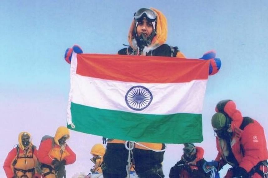 A photo posted by Dinesh Rathod on his Facebook account purporting to depict his wife, Tarakeshwari Rathod, at the summit of Mount Everest.