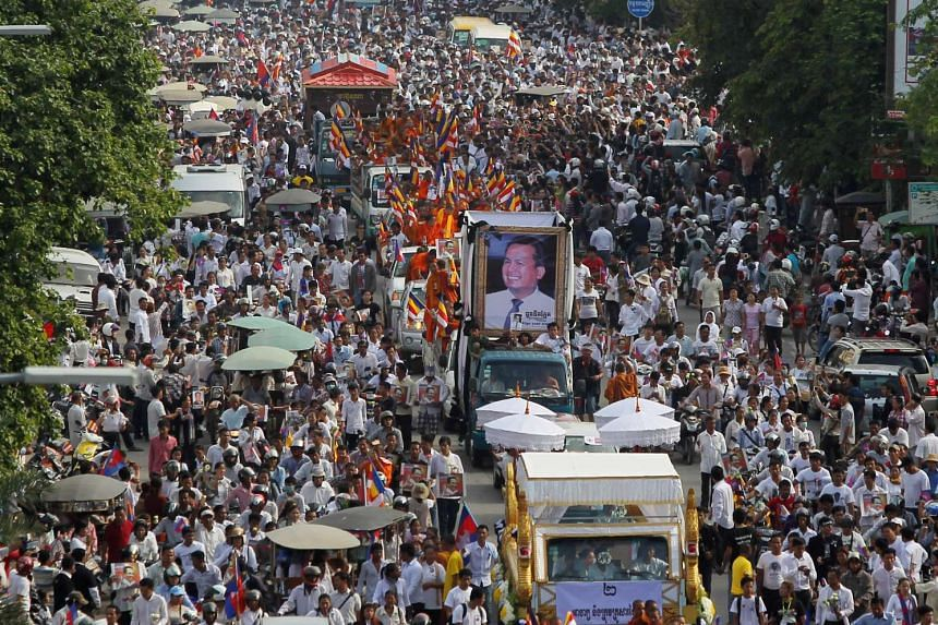 Tens of thousands of people attend a funeral procession to carry the body of Kem Ley on July 24, 2016.