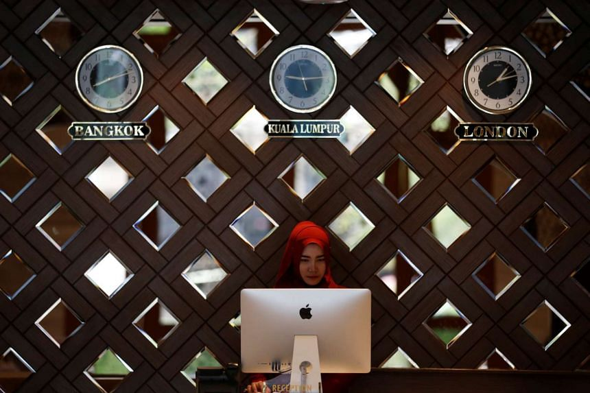 A receptionist working at the Al Meroz hotel, Thailand's first halal hotel.