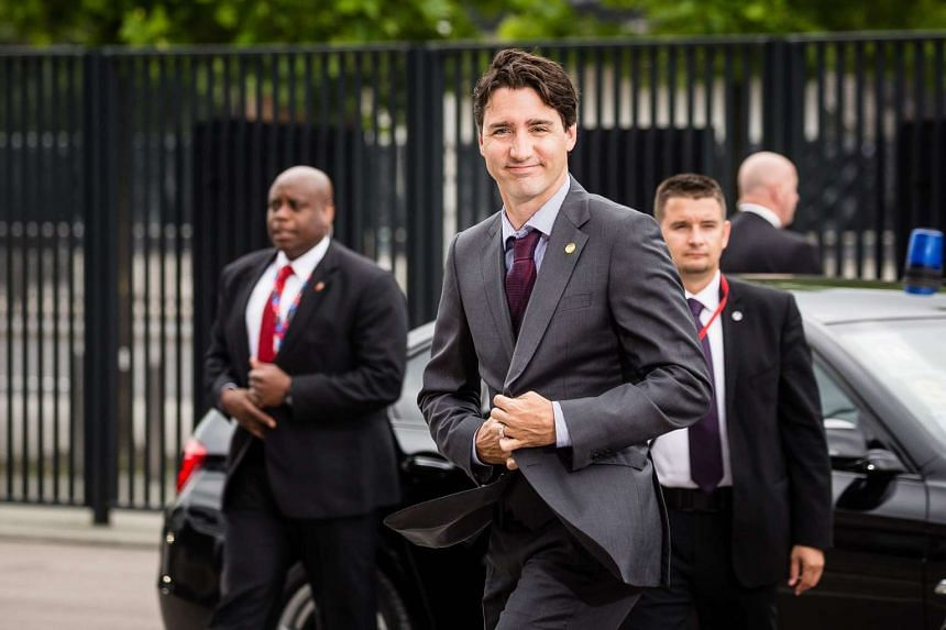 This file photo taken on July 9, shows Canadian Prime Minister Justin Trudeau as he arrives at the Warsaw Stadium entrance for the second day of NATO summit in Warsaw, Poland.
