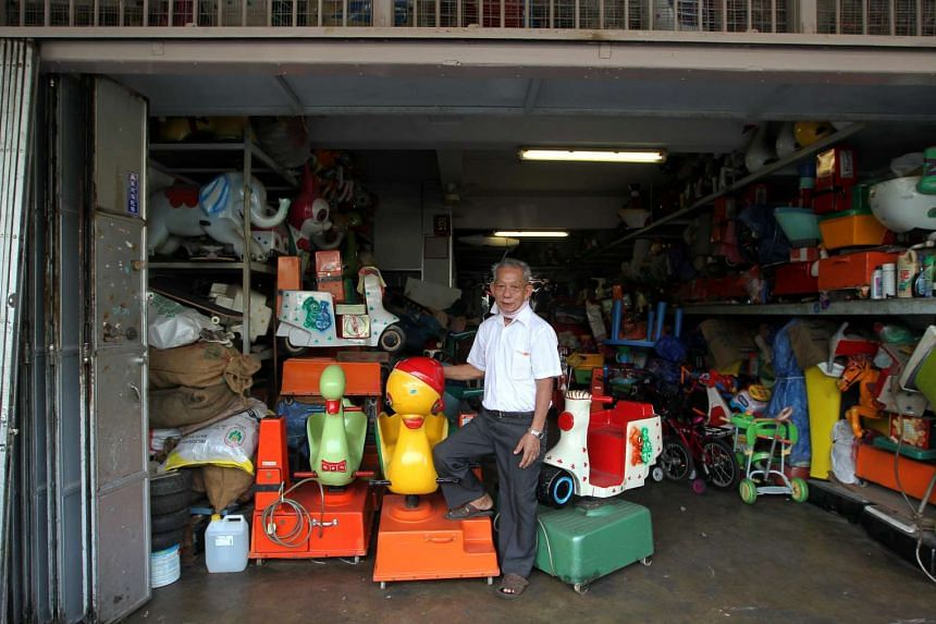 """Mr Lee Kim Leng in his shop in Serangoon Garden with two of the most popular rides, the """"Big Head Duck"""" and """"Vespa"""". The family business used to produce and supply its own kiddy rides."""