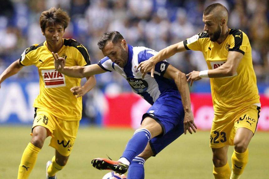 Deportivo Coruna's Lucas Perez (centre) in action against players from Spanish side Eibar on Aug 19, 2016.