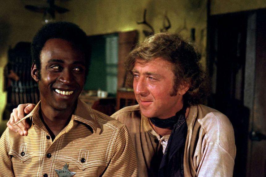 Gene Wilder (right) starred alongside Cleavon Little in the comic western Blazing Saddles in 1974.