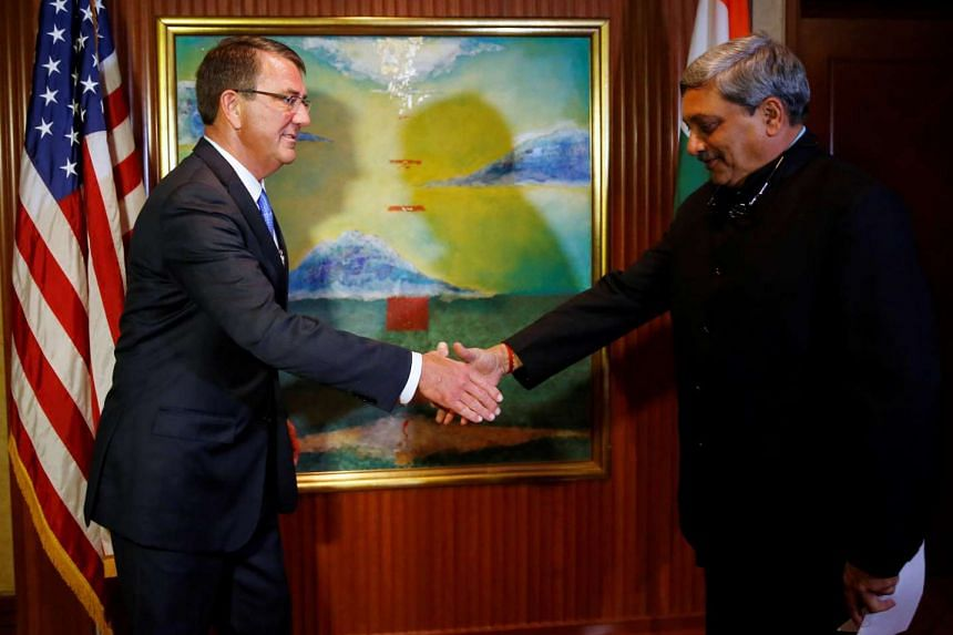 US Secretary of Defence Ash Carter meets India's Defence Minister Manohar Parrikar for a bilateral at the IISS Shangri-La Dialogue in Singapore on June 4, 2016.