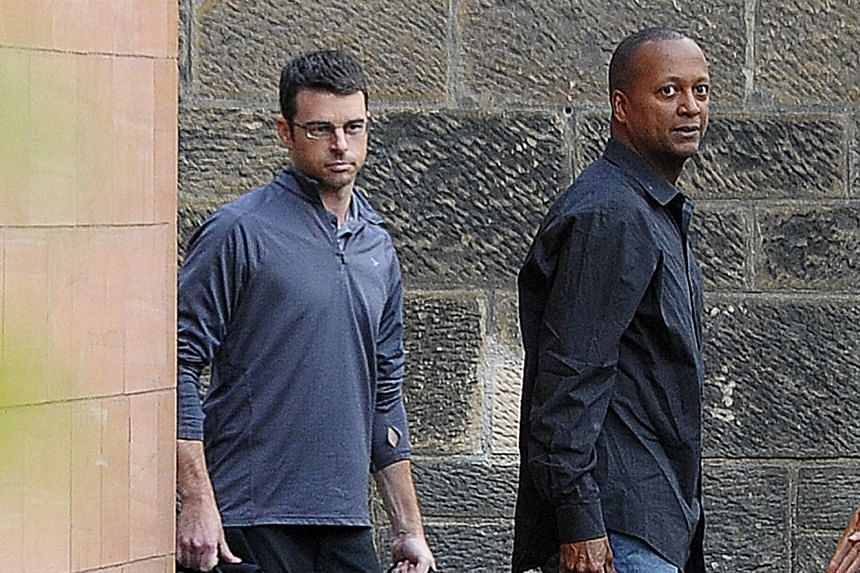 United Airlines pilots Brady Grebenc (left) and Carlos Licona are pictured as they leave Paisley Sherrif Court in Glasgow after being freed on bail.