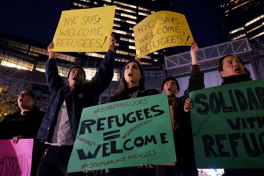 Human rights activists and people from the Muslim community demonstrate in New York in solidarity for Syrian and Iraqi refugees in Dec, 2015.