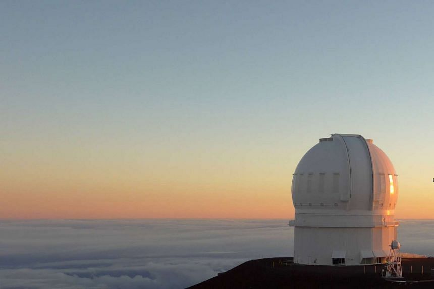 An astronomical observatory in Hawaii scans the heavens for signs of life.