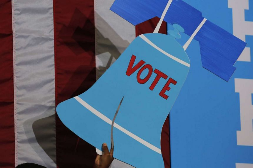 A sign in the shape of the US Liberty Bell is displayed before Democratic presidential nominee Hillary Clinton arrives at a voter registration rally in Pennsylvania.