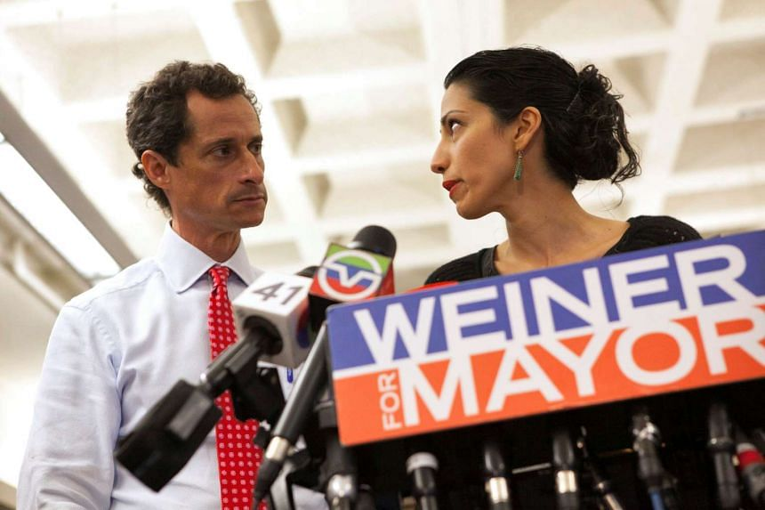 Anthony Weiner and his wife Huma Abedin attend a news conference when he was running for New York mayor in 2013.