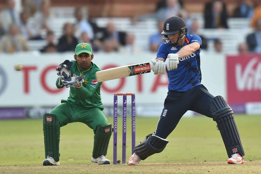 England's Chris Woakes (right) hits the winning runs as England win the second one day international (ODI) cricket match between England and Pakistan at Lord's cricket ground in London on Aug 27.