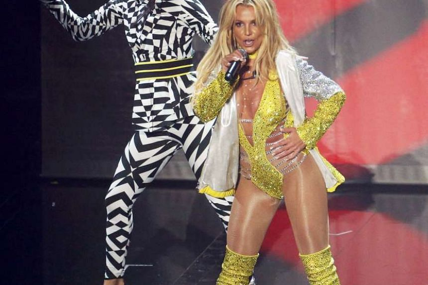 Rihanna with the Michael Jackson Video Vanguard Award; and Britney Spears (above) performing on the Video Music Awards stage for the first time in a decade.
