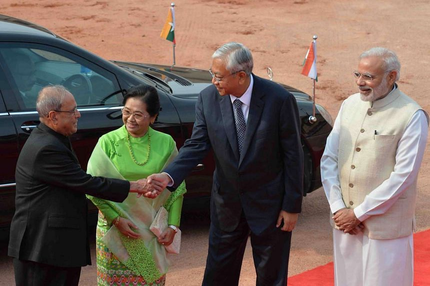 Myanmar's President U Htin Kyaw (second from right) and his wife Su Su Lwin are greeted by Indian President Pranab Mukherjee (far left) in India yesterday. With them is Indian Prime Minister Narendra Modi.
