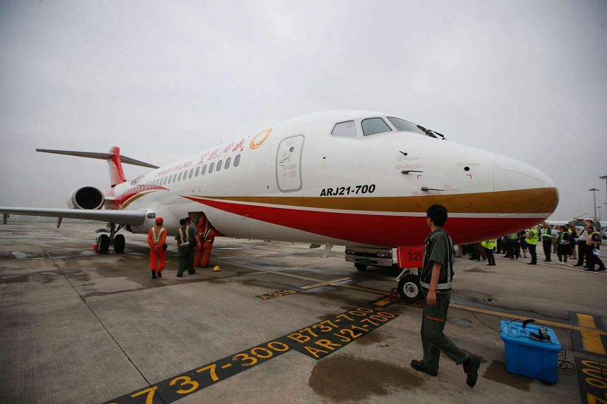 China's first domestically produced regional jet, the ARJ21, arriving at Shanghai Hongqiao Airport after making its first flight from Chengdu to Shanghai on June 28. It is made by the Commercial Aircraft Corporation of China, one of the investors in the n