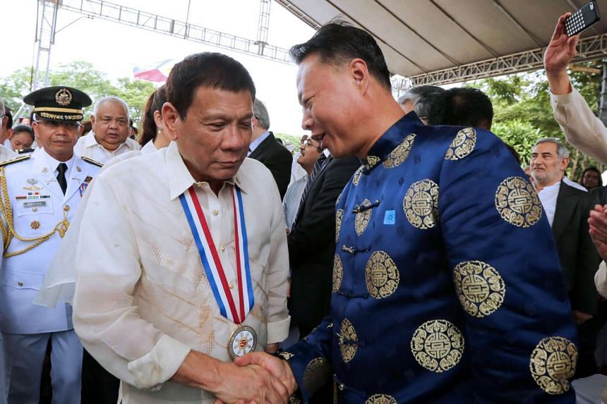 Philippine President Duterte greeting Chinese Ambassador Zhao during an event to mark National Heroes Day in Manila yesterday.