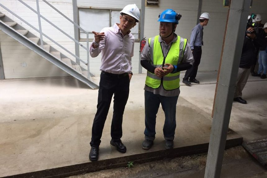 Minister of State for Manpower Teo Ser Luck inspects the construction site.