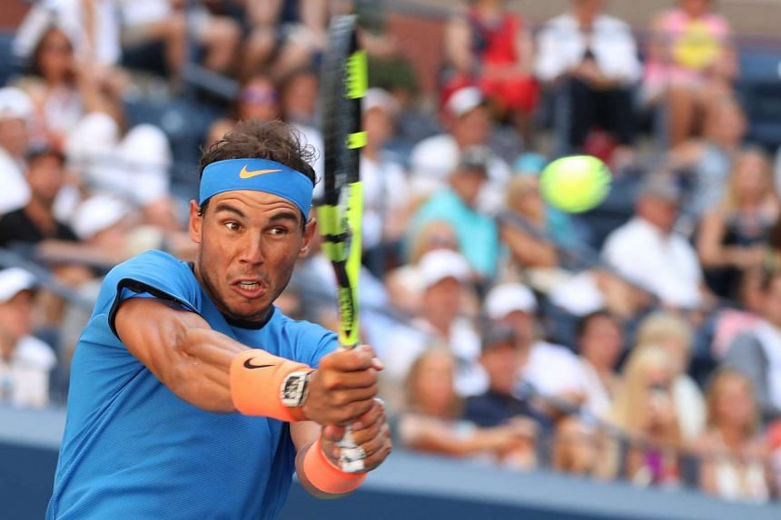 Rafael Nadal of Spain hits a return to Denis Istomin of Uzbekistan during their match on the first day of the US Open Tennis Championship at the USTA National Tennis Center in Flushing Meadows, New York.