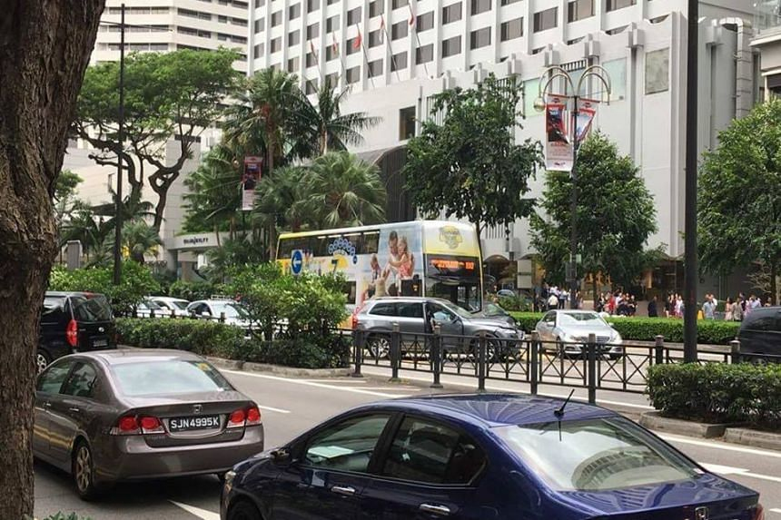 A ComfortDelGro taxi was exiting Claymore Hill beside Shaw House when it hit a Toyota Alphart and a Hyundai Avante, then rammed into a passing Volvo on the other side of the road before coming to a halt.
