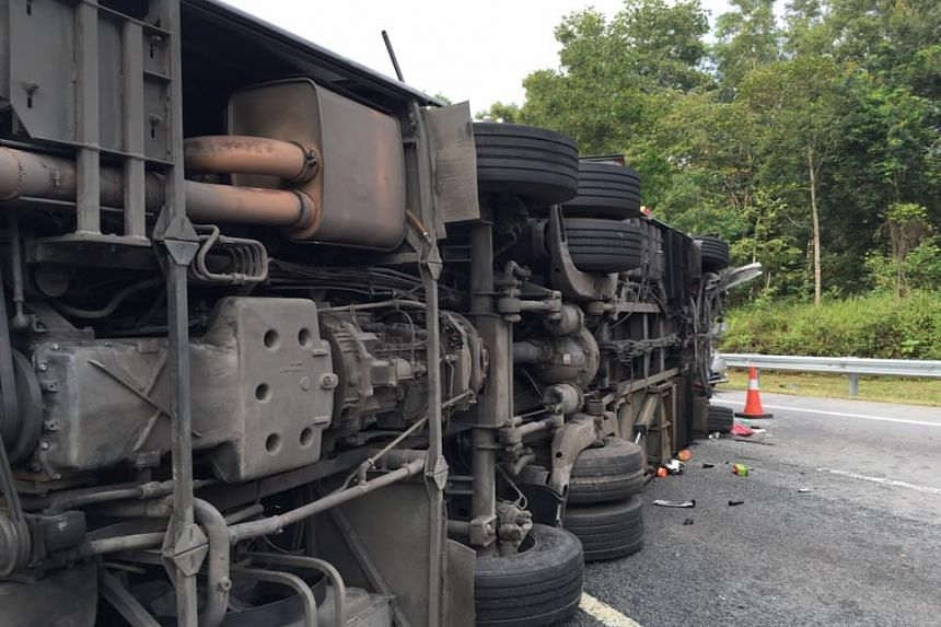 A tour bus overturned on the Karak-KL highway while returning from Genting Highlands, on Aug 31, 2016.