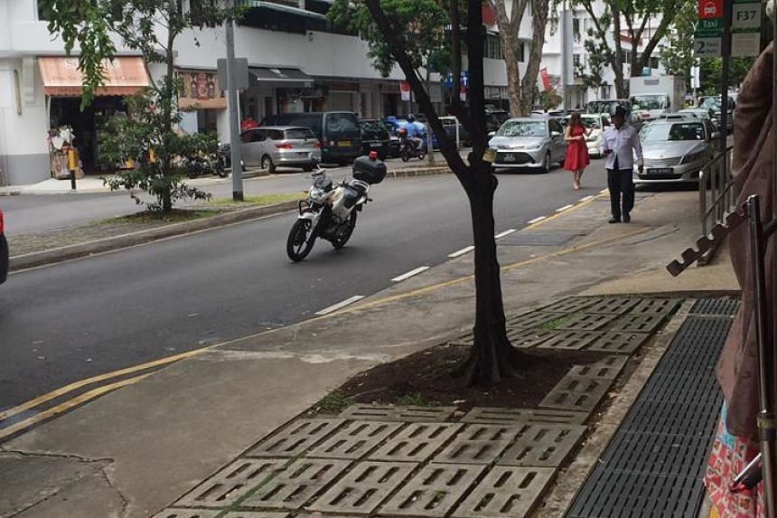 A viral Facebook post shows a photo of a motorcycle parked in the centre of the road in Tiong Bahru, allegedly by a parking warden.