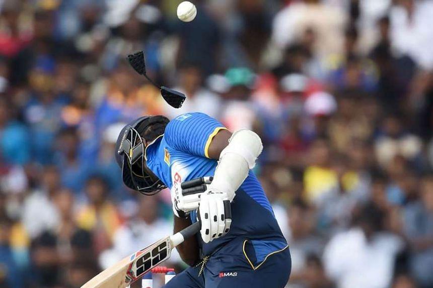 Sri Lanka's captain Angelo Mathews getting hit on the helmet by a ball the One Day International match against Australia in Dambulla, Sri Lanka, on Aug 31, 2016.