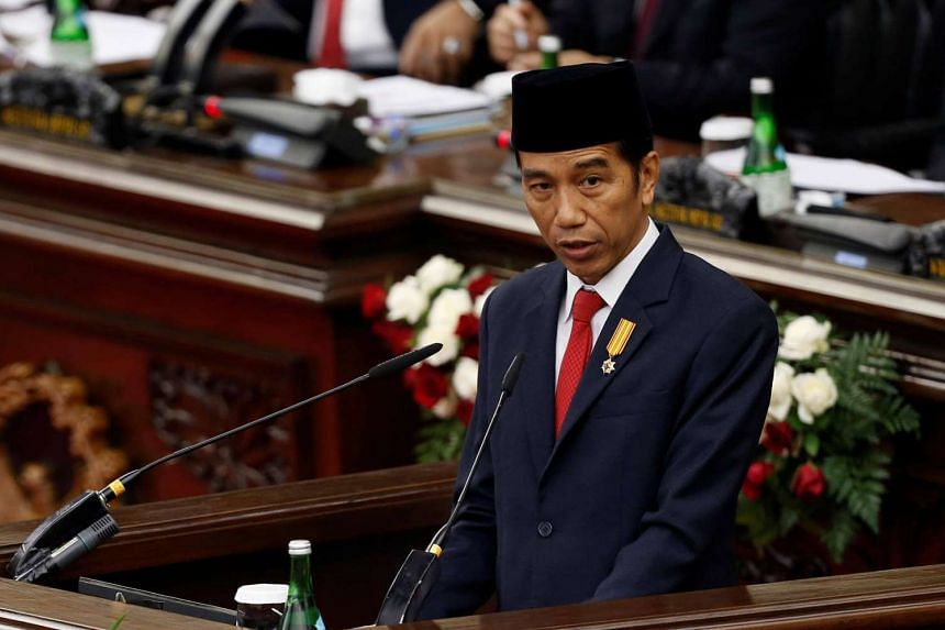 Indonesia's President Joko Widodo delivers a speech in front of Parliament members at the House of Representative in Jakarta on Aug 16, 2016.