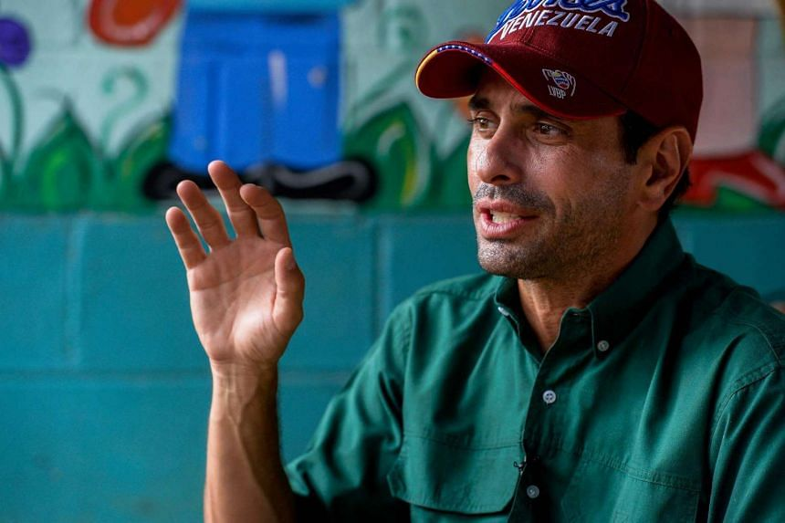 Miranda state governor and opposition leader, Henrique Capriles Radonski, gestures as he speaks during an interview in Higuerote on Aug 26, 2016.