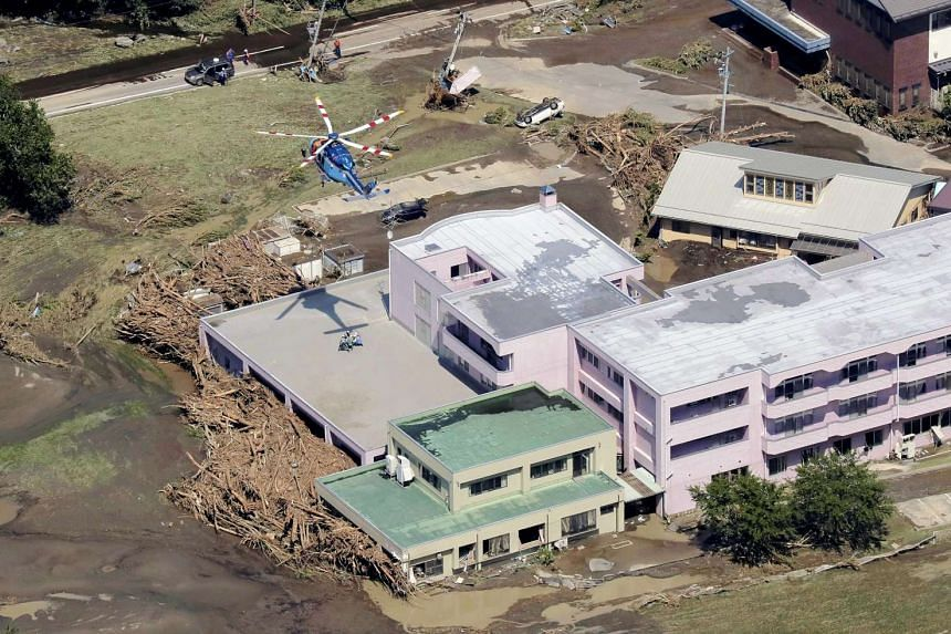 An aerial picture shows rescue operations at the Ran Ran elderly nursing home, where nine people were found dead earlier in the day following floods due to heavy rains generated by typhoon Lionrock in Iwaizumi, Iwate prefecture, north-eastern Japan,