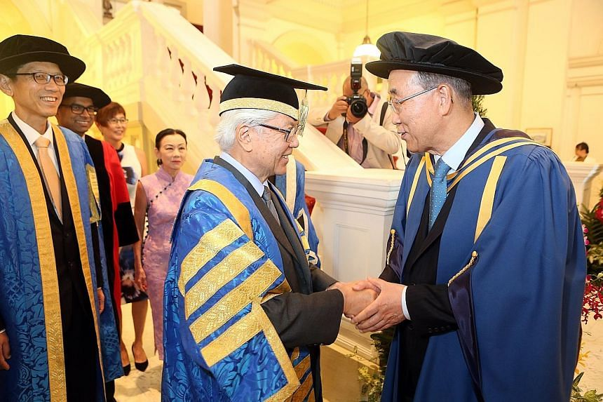President Tan with Mr Ban at yesterday's ceremony at the Istana, where the UN chief received an honorary Doctor of Letters degree from NUS. Dr Tan is also the NUS chancellor.