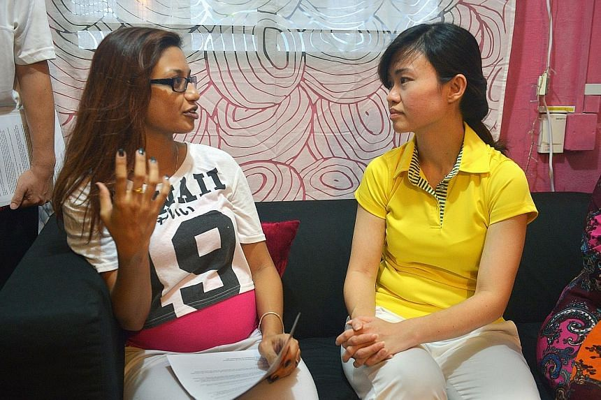 MacPherson MP Tin Pei Ling speaking to Ms Sulaiha Ngatiman at her home yesterday. The Aljunied Crescent resident, who is seven months pregnant, says she uses mosquito coils and applies insect repellent but is still worried about her baby. Ms Tin visi