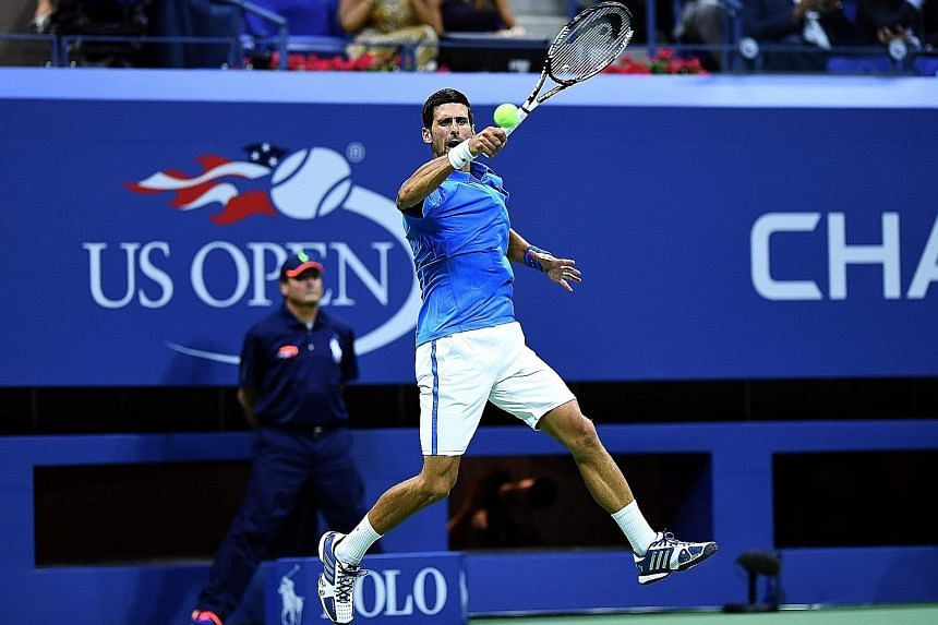 Serbia's Novak Djokovic hitting a return against Jerzy Janowicz of Poland during their US Open first-round match on Monday. The Serb won 6-3, 5-7, 6-2, 6-1 and will next face Jiri Vesely of the Czech Republic.