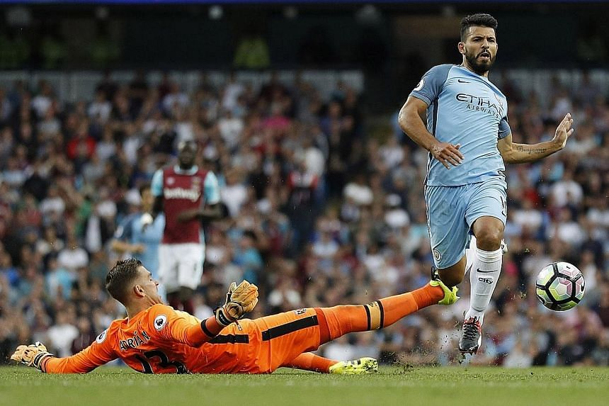 Sergio Aguero in action with West Ham goalkeeper Adrian in Manchester City's 3-1 Premier League win on Sunday. The striker suffered a calf injury towards the end of the match.