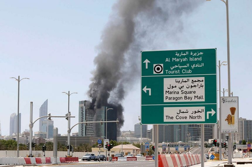 Smoke rises after a fire broke out in a building at Al Maryah Island in Abu Dhabi on Aug 30, 2016.
