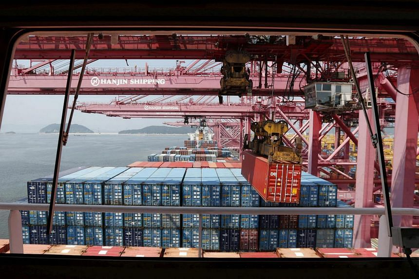 A crane carries a container from a ship of Hanjin Shipping at Hanjin container terminal at the Busan New Port in Busan.