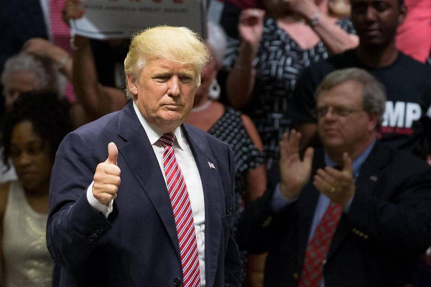 Donald Trump gives a thumbs-up after his speech at a campaign rally in Austin, Texas, on Aug 22, 2016.