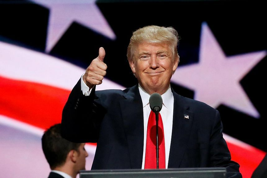 Republican presidential nominee Donald Trump gives a thumbs up during his walk through at the Republican National Convention in Cleveland, US on July 21, 2016.