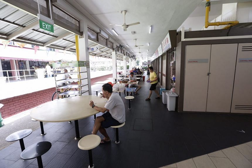 Empty seats are seen at Macpherson Market and Food Centre at about 12.30pm on Aug 31, 2016.