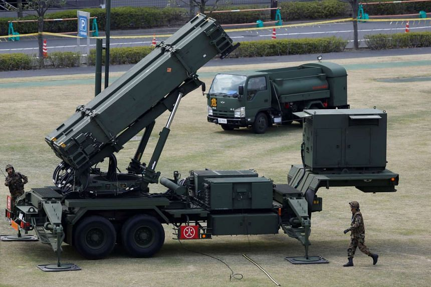 Japan Self-Defence Forces soldiers prepare to refuel a unit of Patriot Advanced Capability-3 (PAC-3) missiles at the Defence Ministry in Tokyo.