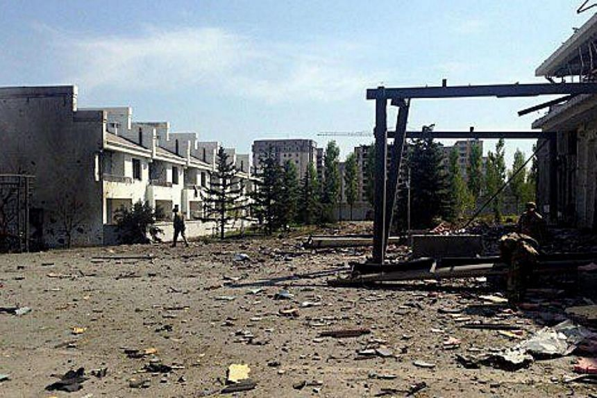 A general view showing damages outside of the building of the Chinese Embassy in the aftermath of a terrorist attack in Bishkek, Kyrgyzstan on Aug 30, 2016.