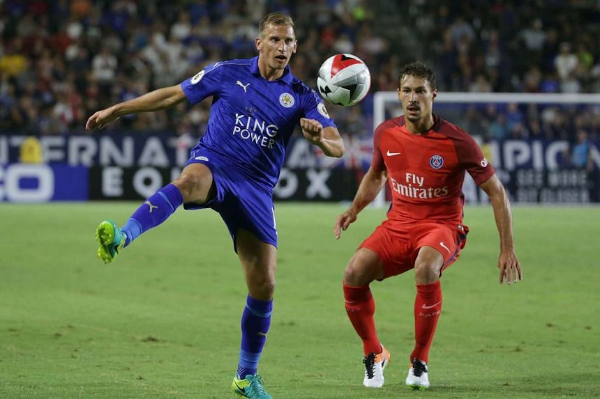 Marc Albrighton (left) in action against Benjamin Stambouli of Paris Saint-Germain in the 2016 International Champions Cup.
