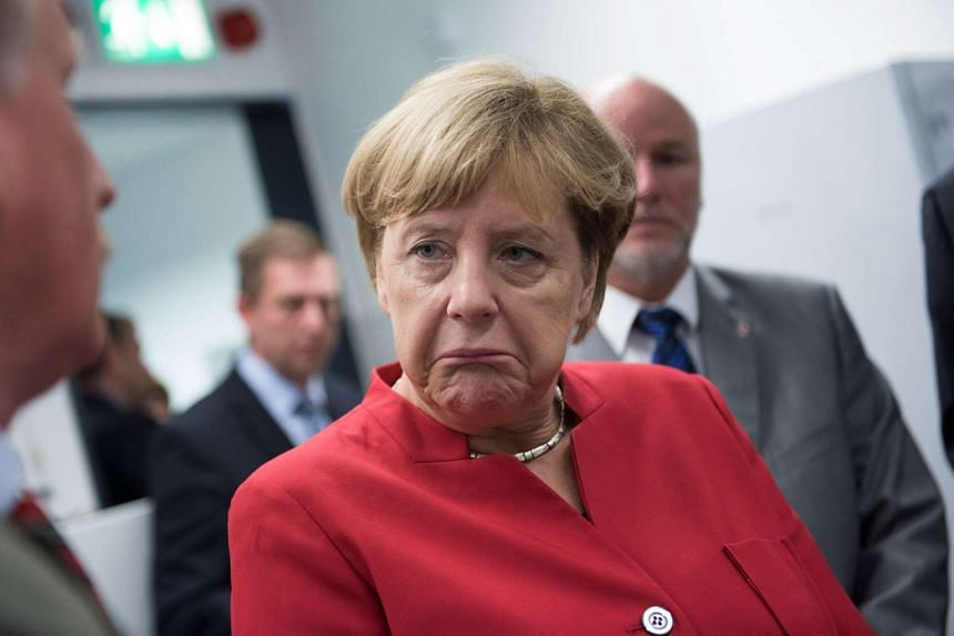 German Chancellor Angela Merkel visiting a science institute in Germany, on Aug 30, 2016.