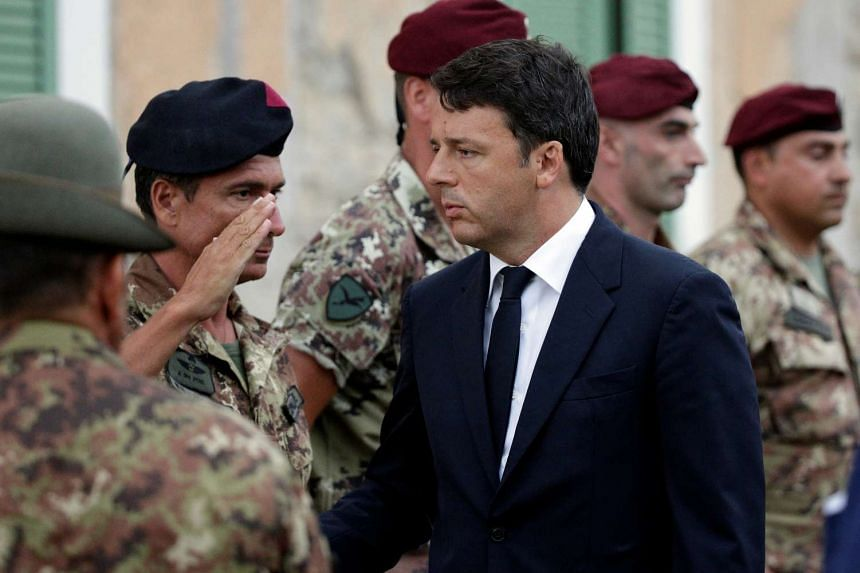 Italian Prime Minister Matteo Renzi arrives prior to a funeral service for victims of the earthquake that levelled the town in Amatrice, central Italy, Aug 30, 2016.